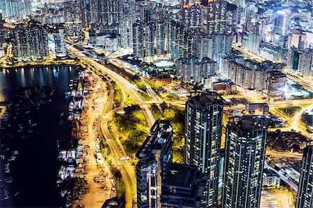 Aerial of Kowloon at night, with light trails, Hong Kong, China Stock Photo - Premium Royalty-Free, Code: 649-08180332