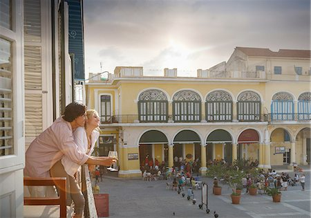 Romantic young couple looking out from restaurant balcony in Plaza Vieja, Havana, Cuba Stock Photo - Premium Royalty-Free, Code: 649-08180382