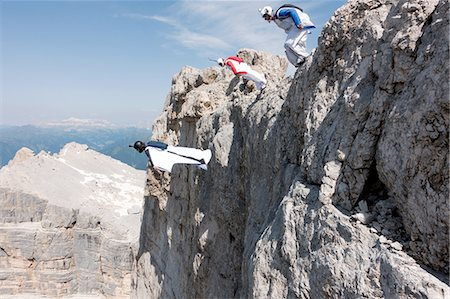Three male BASE jumpers exiting from mountain top, Dolomites, Italy Stock Photo - Premium Royalty-Free, Code: 649-08180698
