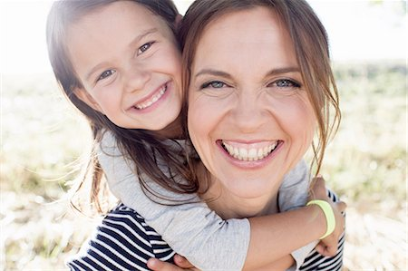 fun - Portrait of mature woman giving daughter piggy back in park Stock Photo - Premium Royalty-Free, Code: 649-08237786