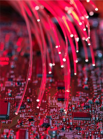 fibre optic - Fibre optics flowing through circuit boards from a laptop computer, close-up Stock Photo - Premium Royalty-Free, Code: 649-08237901
