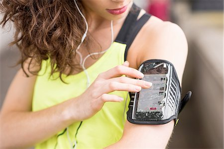 finger - Cropped close up of female runner choosing music on smartphone armband Stock Photo - Premium Royalty-Free, Code: 649-08238084