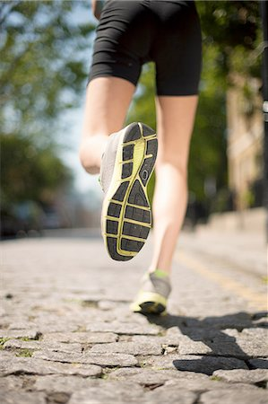 sole - Runner jogging on cobbled street Stock Photo - Premium Royalty-Free, Code: 649-08238339