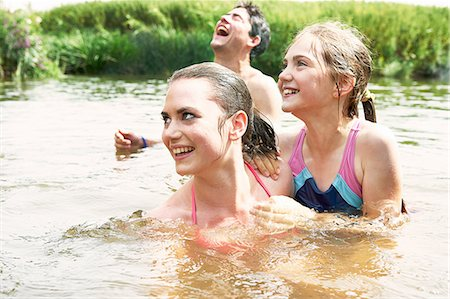 preteen swimsuit - Two sisters and friend swimming in rural lake Stock Photo - Premium Royalty-Free, Code: 649-08238774