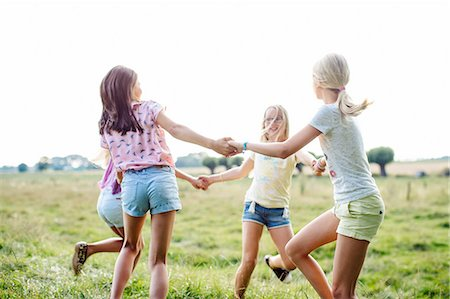 preteen dancing - Girls dancing in ring on field, Flanders, Belgium Stock Photo - Premium Royalty-Free, Code: 649-08238949