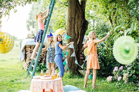Girls decorating garden for summer party Stock Photo - Premium Royalty-Free, Code: 649-08238968