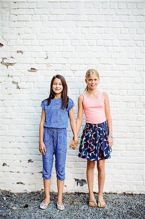 Girls posing against white wall Stock Photo - Premium Royalty-Free, Code: 649-08238992