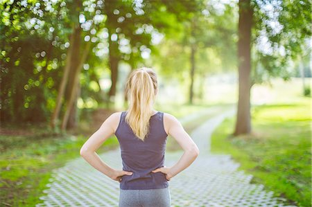 photography - Young girl, outdoors, hands on hips, preparing herself for run Stock Photo - Premium Royalty-Free, Code: 649-08232439