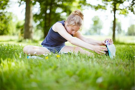 preteen girls stretching - Young girl in park, doing stretches on grass Stock Photo - Premium Royalty-Free, Code: 649-08232442