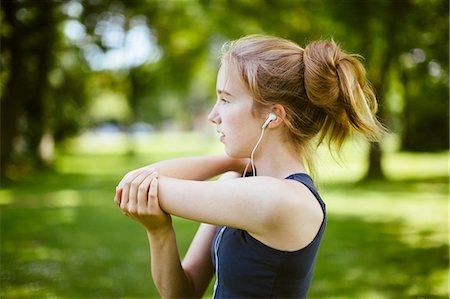 preteen girls stretching - Young girl in park, doing arm stretches Stock Photo - Premium Royalty-Free, Code: 649-08232443