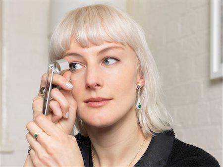 diamond - Female jeweler examining diamond using magnifier in jewellery shop Stock Photo - Premium Royalty-Free, Code: 649-08232742