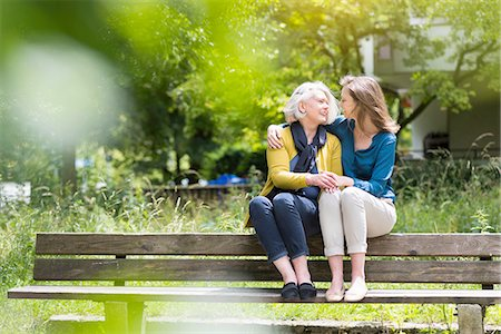 Senior woman and daughter chatting and holding hands on park bench Stock Photo - Premium Royalty-Free, Code: 649-08232844