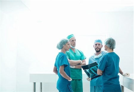 people hospital - Male and female orthopedic surgeons discussing x-ray image in hospital Stock Photo - Premium Royalty-Free, Code: 649-08232875
