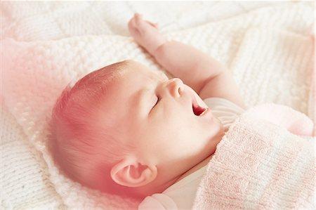 Baby yawning in sleep Stock Photo - Premium Royalty-Free, Code: 649-08306510