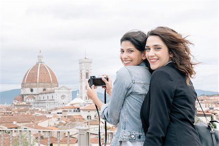 Lesbian couple taking photo of Florence Cathedral and Giotto's Campanile looking over shoulder smiling, Florence, Tuscany, Italy Stock Photo - Premium Royalty-Free, Code: 649-08306709