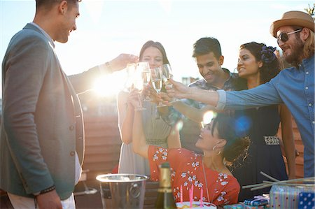 Friends at outdoor party making a toast Stock Photo - Premium Royalty-Free, Code: 649-08307012