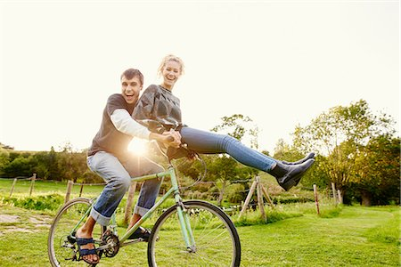 Young woman sitting on boyfriends bicycle handlebars Stock Photo - Premium Royalty-Free, Code: 649-08307332