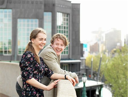 Young couple enjoying view from terrace, Melbourne, Victoria, Australia Stock Photo - Premium Royalty-Free, Code: 649-08307357