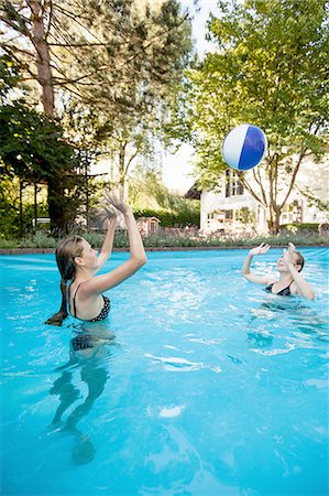 Two teenage girls playing with beach ball in swimming pool Stock Photo - Premium Royalty-Free, Code: 649-08307538