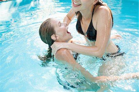 Two teenage girls jumping in swimming pool Stock Photo - Premium Royalty-Free, Code: 649-08307533