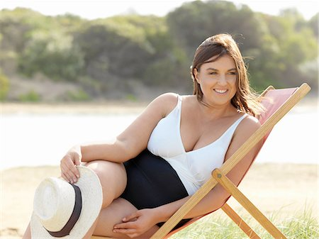 fat lady sitting - Woman in swimsuit sitting on beach chair, Point Impossible, Victoria, Australia Stock Photo - Premium Royalty-Free, Code: 649-08327603