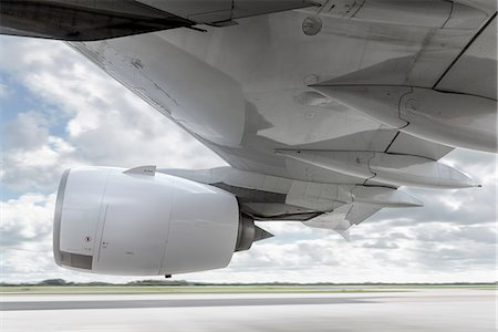 detail - View of engine and wing on speeding A380 aircraft Stock Photo - Premium Royalty-Free, Code: 649-08327935