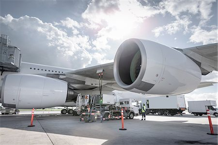 A380 aircraft being refuelled at airport Stock Photo - Premium Royalty-Free, Code: 649-08327944