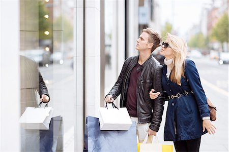purchase - Young couple window shopping, London, England, UK Stock Photo - Premium Royalty-Free, Code: 649-08328053