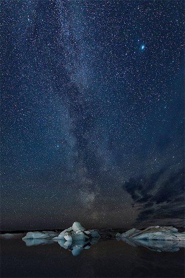Starry sky and icebergs at night, Jokulsarlon, Iceland Stock Photo - Premium Royalty-Free, Image code: 649-08328129