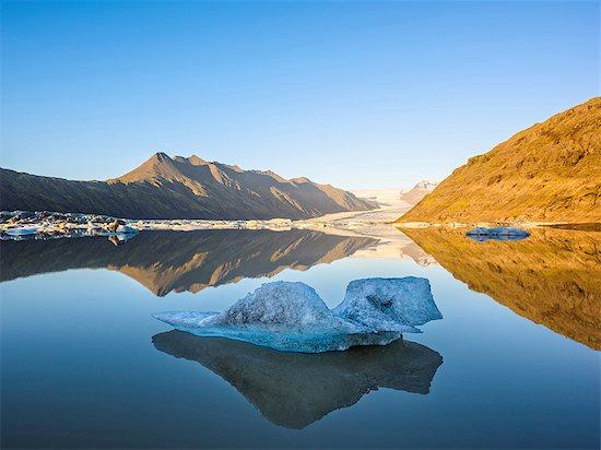 Ice on lake at sunset, Heinabergsjokull Glacier, Iceland Stock Photo - Premium Royalty-Free, Image code: 649-08328131