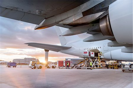 Ground crew loading A380 aircraft at sunset Stock Photo - Premium Royalty-Free, Code: 649-08328203