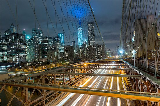 Elevated view of Brooklyn bridge and Manhattan financial district skyline at night, New York, USA Stock Photo - Premium Royalty-Free, Image code: 649-08328531