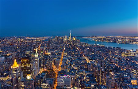 High angle cityscape of Manhattan financial district and One World Trade Centre at dusk, New York, USA Stock Photo - Premium Royalty-Free, Code: 649-08328554