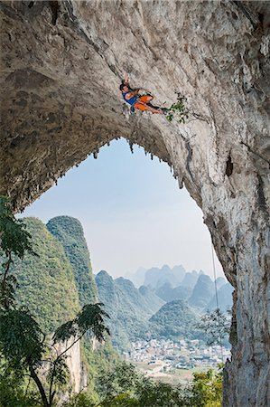 Male climber climbing the route Lunatic on Moon Hill in Yangshuo, Guangxi Zhuang, China Stock Photo - Premium Royalty-Free, Code: 649-08328925