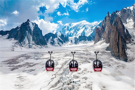 france - Elevated view of three cable cars over snow covered valley at Mont blanc, France Stock Photo - Premium Royalty-Free, Code: 649-08328979