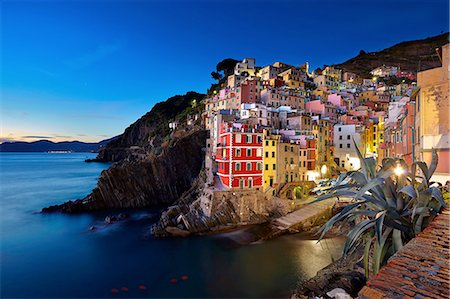 Waterfront town of Riomaggiore at night, Italy Stock Photo - Premium Royalty-Free, Code: 649-08328994