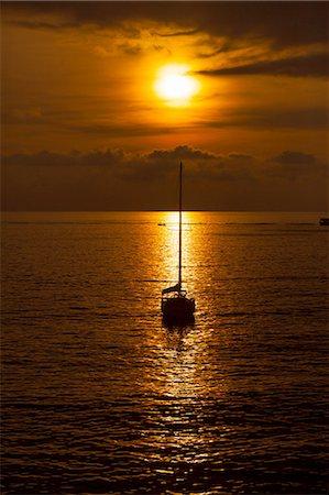 Silhouetted yacht at sunset, Camogli, Liguria,  Italy Stock Photo - Premium Royalty-Free, Code: 649-08381771
