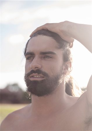 shirtless men - Bearded young man with ponytail Stock Photo - Premium Royalty-Free, Code: 649-08422825
