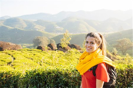 picture - Portrait of young woman in tea plantations near Munnar, Kerala, India Stock Photo - Premium Royalty-Free, Code: 649-08480037