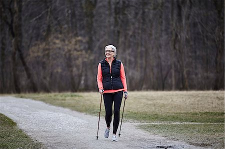 Mature female training in park, nordic walking with poles Stock Photo - Premium Royalty-Free, Code: 649-08544132