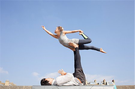 practise - Man and woman practicing acrobatic yoga on wall Stock Photo - Premium Royalty-Free, Code: 649-08544223