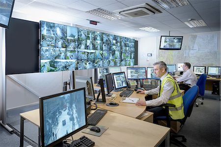security - Security guards in security control room with video wall Stock Photo - Premium Royalty-Free, Code: 649-08548570