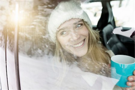 Woman having coffee inside vehicle Stock Photo - Premium Royalty-Free, Code: 649-08549074