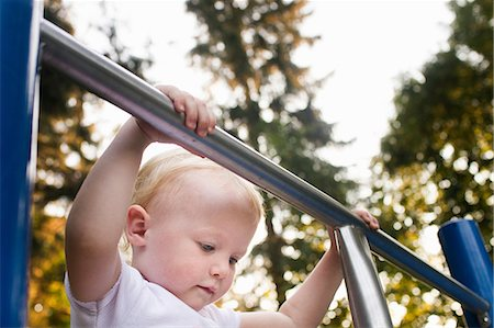 Baby girl on climbing frame at park Stock Photo - Premium Royalty-Free, Code: 649-08543168