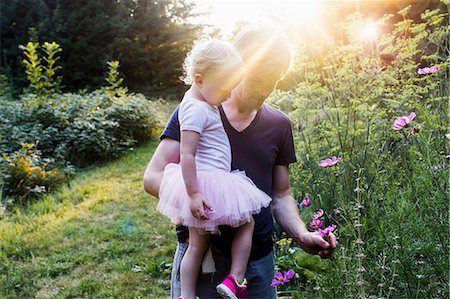 Father and daughter in rural setting, picking wild flowers Stock Photo - Premium Royalty-Free, Code: 649-08543170
