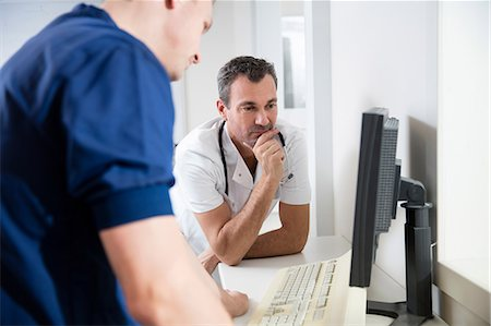 results - Doctors examining CT scans on monitor in CT x-ray scanner control room Stock Photo - Premium Royalty-Free, Code: 649-08543374