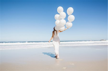 dress - Full length rear view of woman on beach wearing white dress holding balloons Stock Photo - Premium Royalty-Free, Code: 649-08543897