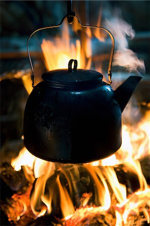 A kettle boils on top of a fire in a lavvu, a temporary home and tent of the Sami people, in Kirkeness, northern Norway Stock Photo - Premium Royalty-Free, Code: 649-08564841