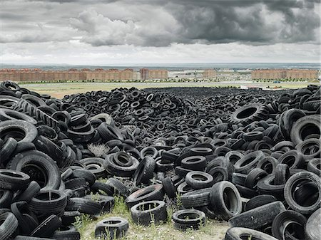 Pile of old tyres outside of city Stock Photo - Premium Royalty-Free, Code: 649-08565331
