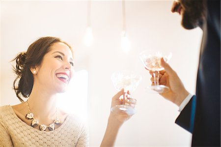 Stylish young couple raising a toast before night out Stock Photo - Premium Royalty-Free, Code: 649-08565965